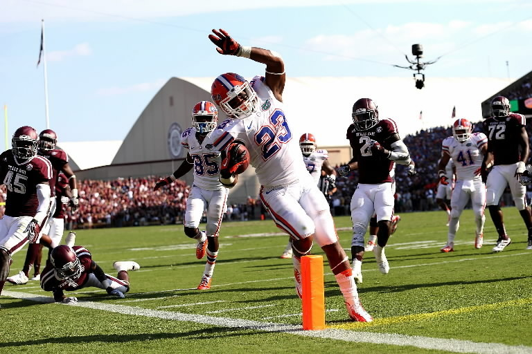 Mike Gillislee of the Florida Gators scores a touchdown against the Texas A&M Aggies at Kyle Field on September 8, 2012, in College Station, Texas.