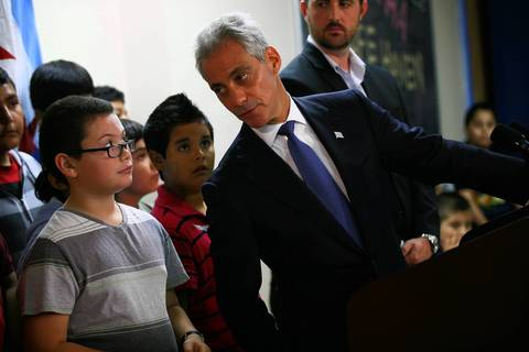 Mayor Rahm Emanuel confers with a student while addressing reporters at Maranatha Church, a site hosting the Safe Haven program.
