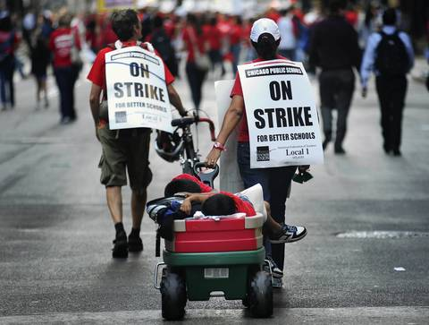 Protestors march north on LaSalle Street in the Loop on the first day of the Chicago Teacher Union strike.
