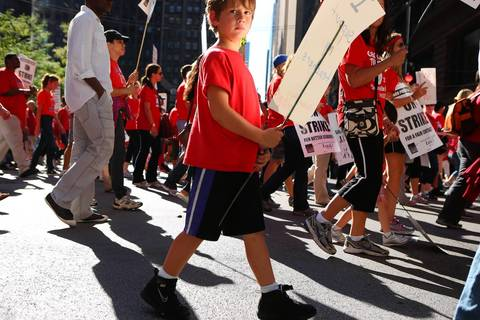 Chicago teachers and their supporters rally in Chicago on the second day of the Chicago teacher's strike.