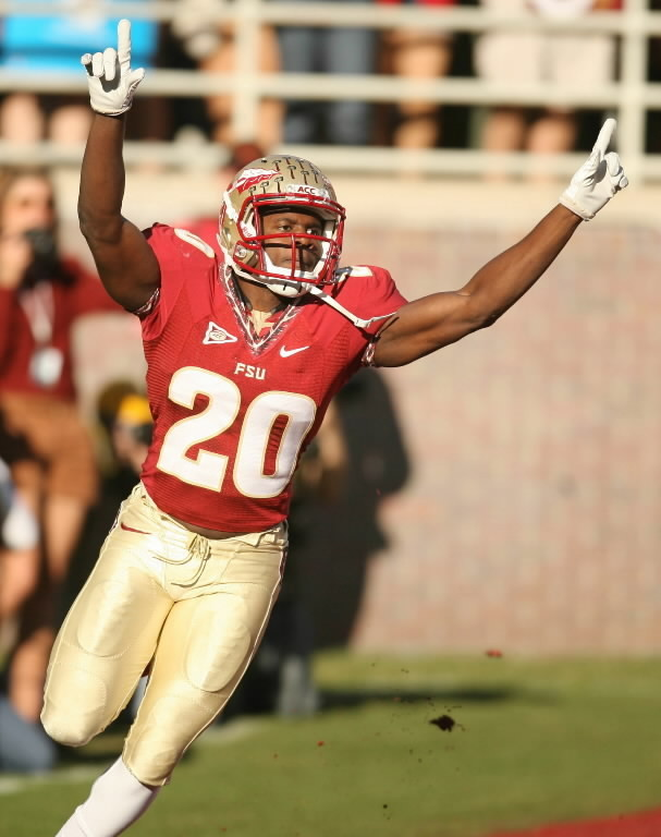 FSU's Lamarcus Joyner celebrates after he scored a touchdown against Miami that was called back after review at Doak Campbell Stadium in Tallahassee on Saturday, November 12, 2011.