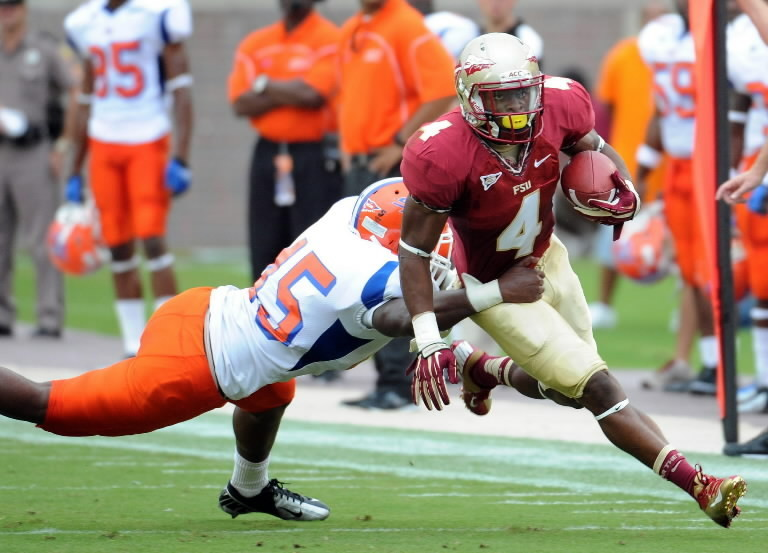 FSU running back Chris Thompson (4) runs the ball past Savannah State Tigers linebacker Trevion Ashford (45) during their game at Doak Campbell Stadium in Tallahassee, Florida.