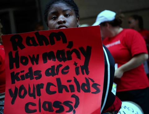 A supporter of the Chicago Teachers Union strike holds a sign outside Chicago Public Schools headquarters.