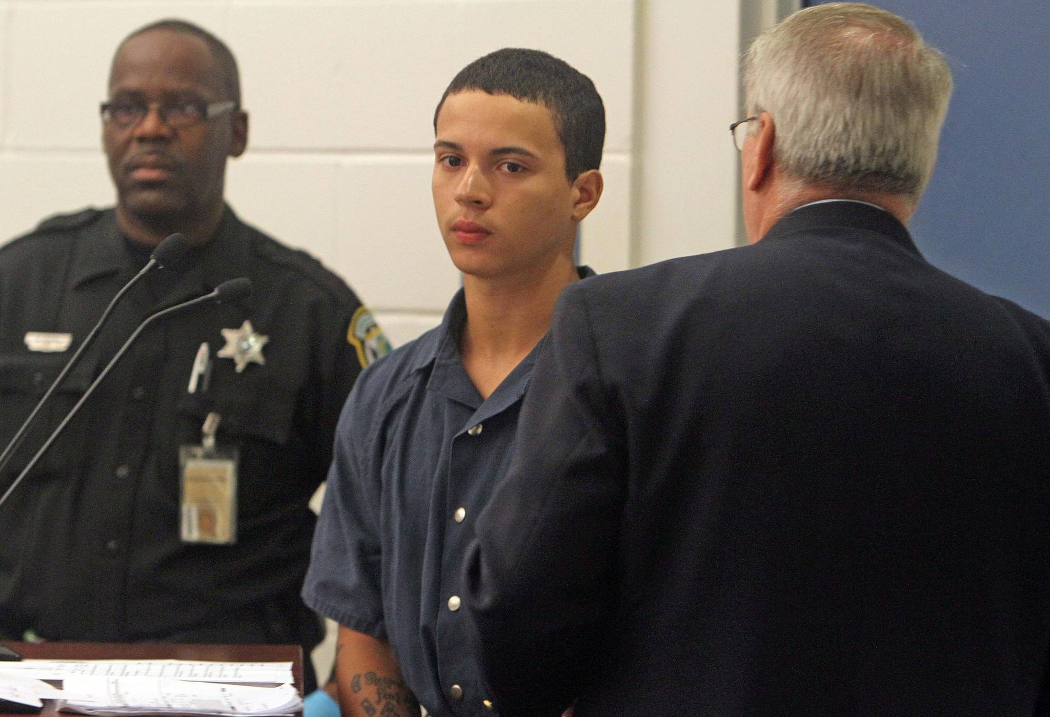 Charles Dessus, 18, center, makes his initial court appearance Wednesday, September 12, 2012 at the Orange County Jail.