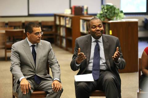 Chicago Schools Superintendent Jean-Claude Brizard (right) speaks as Board of Education Vice President Jesse Ruiz (left) listens in during a round table discussion at Roberto Clemente Community Academy in Chicago.