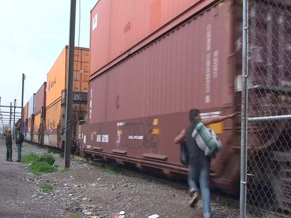 A 20-year-old Honduran attempts to board a train in Tultitlan on the outskirts of Mexico City.