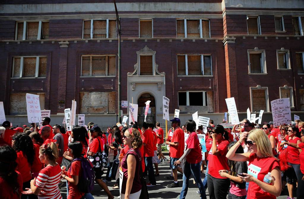 Chicago Teachers Union members rally near Marshall High School on the West Side of Chicago.