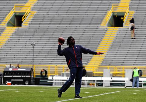 Bears cornerback Charles Tillman is the first player on the field to warm up.