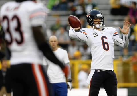 Bears quarterback Jay Cutler warms up to face the Packers.