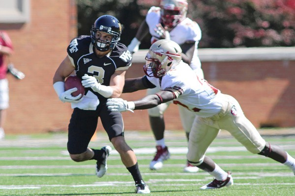 Wake Forest wide receiver Michael Campanaro (3) catches a short pass while being pursued by Florida State linebacker Telvin Smith (22) in the first quarter at BB&amp;T Field on Oct. 8, 2011.
