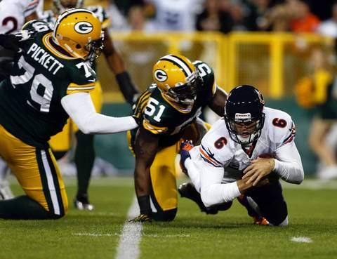 Quarterback Jay Cutler is sacked by the Packers' D.J. Smith on the Bears first possession.
