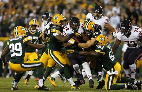 Running back Matt Forte is tackled by the Packers defense.