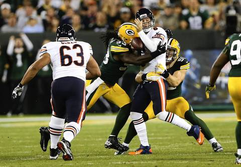 Packers linebacker Erik Walden sacks Bears quarterback Jay Cutler in the first quarter.
