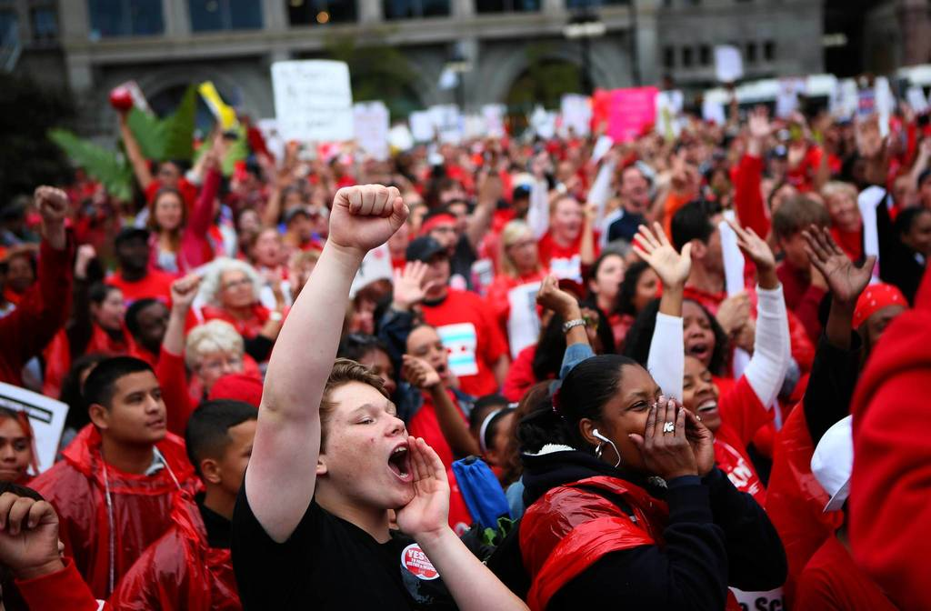 Chicago Teachers Union members and supporters, including some students, rally in Congress Plaza on Michigan Avenue in downtown Chicago.