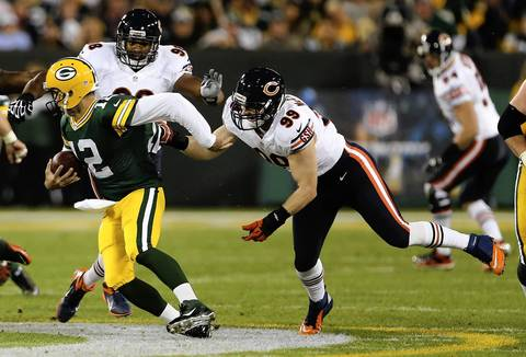 Shea McClellin (99) sacks Packers quarterback Aaron Rodgers in the first quarter.