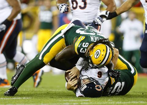 Quarterback Jay Cutler is sacked by Green Bay linebackers Erik Walden and Clay Matthews.