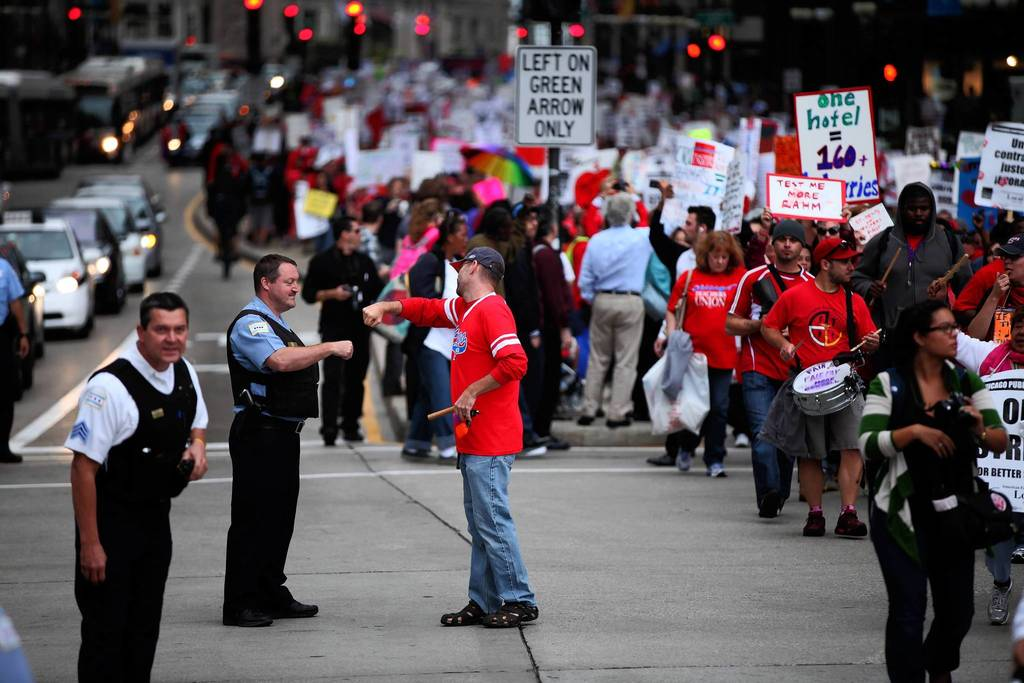 Chicago Teachers Union members and supporters march on Michigan Avenue in downtown Chicago.