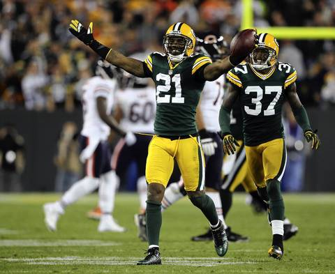 Green Bay's Charles Woodson celebrates after intercepting a pass from Bears QB Jay Cutler in the 4th quarter.