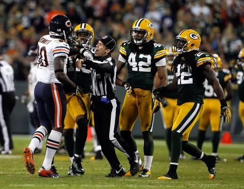 The referee breaks up a scuffle between Earl Bennett and Packers defenders.