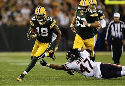 Chris Conte can't stop Green Bay running back Randall Cobb in the 2nd quarter.