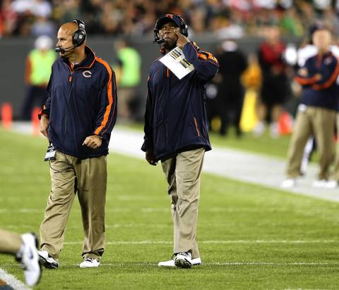 Lovie Smith wipes his face during a break in the action in the second quarter.