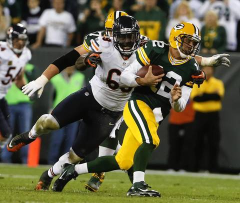 Henry Melton sacks Packers quarterback Aaron Rodgers in the second quarter.
