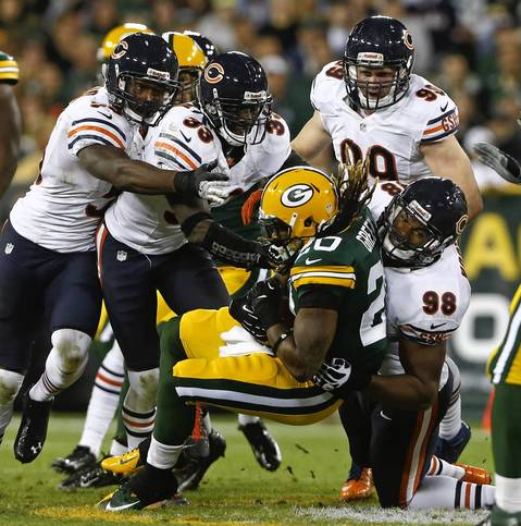 Corey Wootton and teammates bring down Packers running back Alex Green in the second quarter.