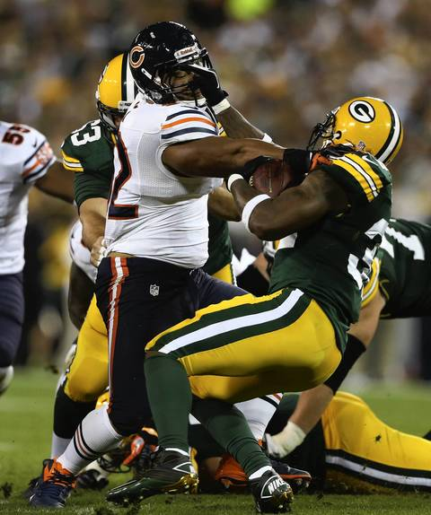 Stephen Paea can't stop Packers running back Cedric Bensen in the 1st quarter.