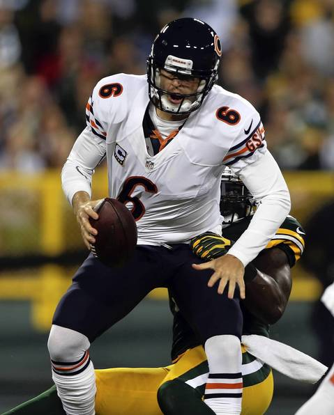 Jay Cutler is sacked by the Packers' D.J. Smith in the 1st quarter.