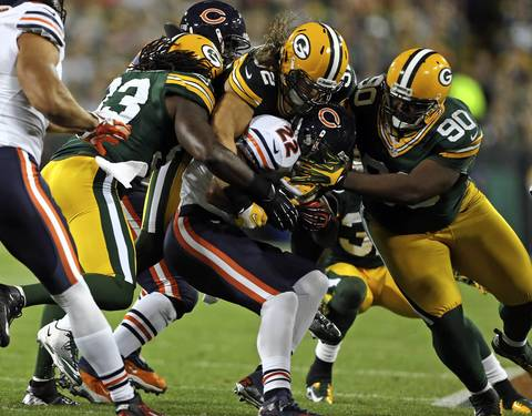 Matt Forte is tackled by the Packers' Erik Walden, Clay Matthews and B.J. Raji in the 1st quarter.
