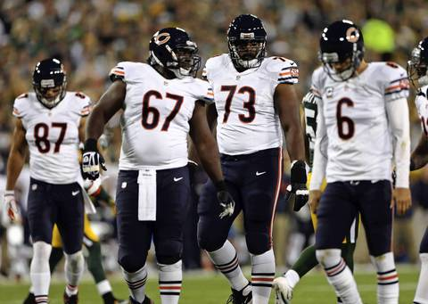 Chris Spencer, J'Marcus Webb and Jay Cutler react to a false start penalty in the 1st quarter.