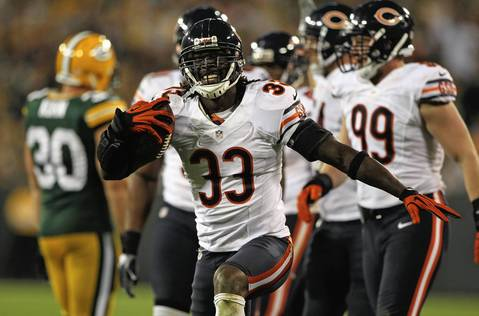 Charles Tillman celebrates recovering fumble from the Packers' Jermichael Finley in the 4th quarter.
