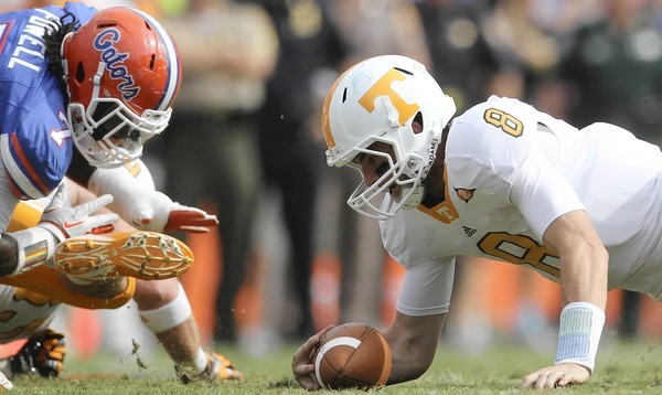 Tennessee quarterback Tyler Bray (8) recovers his own fumble during the first half of their game against Florida at Ben Hill Griffin Stadium in Gainesville, Florida, on Saturday, September 17, 2011.