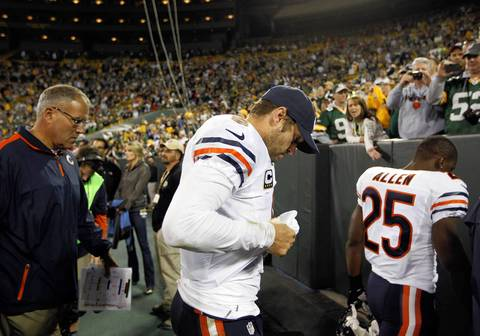 Jay Cutler leaves the field after losing to the Packers 23-10.