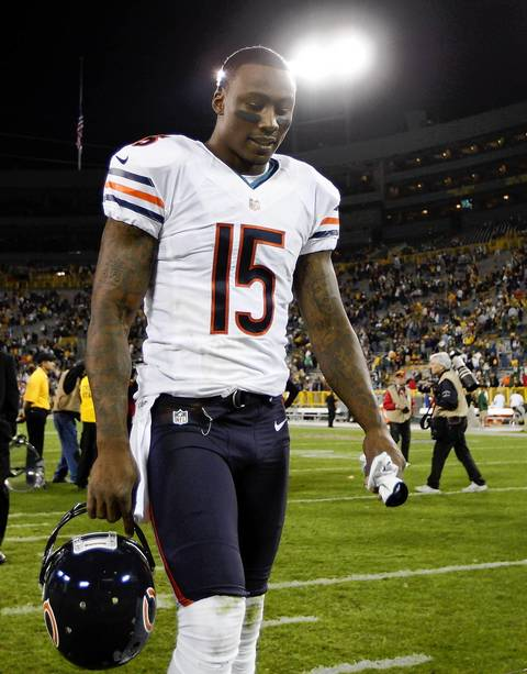 Wide receiver Brandon Marshall leaves the field after losing to the Packers.