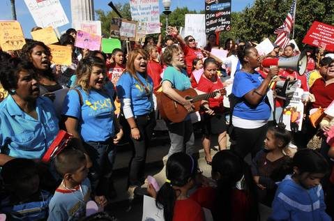 Hundreds of CPS teachers, students and their supporters rally, sing songs and speak out in support for teachers at the Logan Square monument.