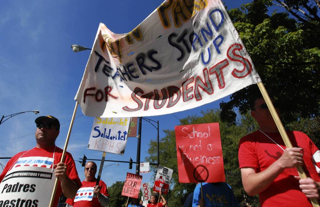 CPS teachers, students and their supporters rally for teachers at the Logan Square monument on day 5 of the teachers strike.