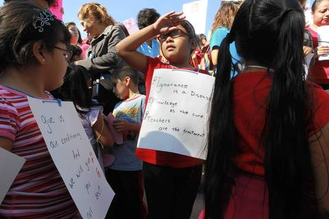 Young students join CPS teachers, and their supporters for a rally for teachers at the Logan Square monument on the day 5 of the strike.