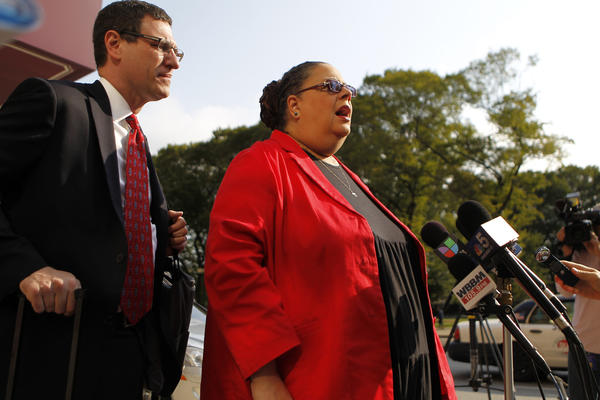 Chicago Teachers Union President Karen Lewis, joined by CTU Vice-President Jesse Sharkey, talks to reporters outside the Hilton Hotel on South Michigan Avenue this morning.