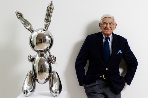 "Eli Broad is pictured in his home with a stainless steel work by Jeff Koons called ""Rabbit."""