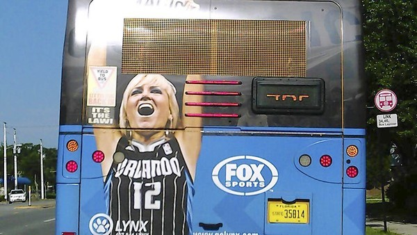 Kristi Slavin's image was used in Orlando Magic advertising like this ad on the back of a city bus. Slavin is suing the basketball team for using her image.