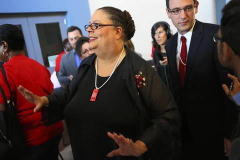 Chicago teachers union members, with president Karen Lewis, gather at the International Union of Operating Engineers union hall to announce a tentative agreement on a new contract.