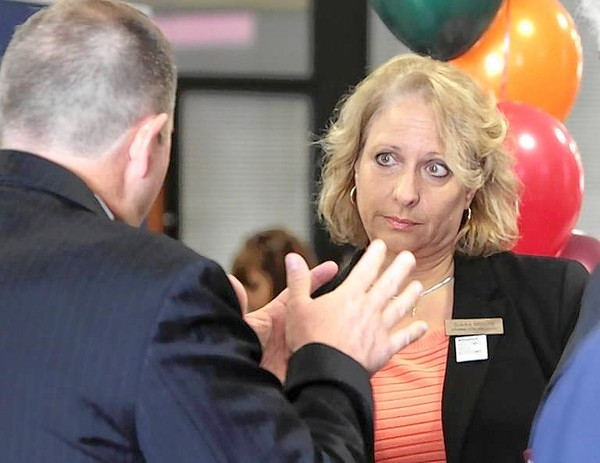New union President Diana Moore talks with Orange County Public Schools' Scott Howat. (George Skene/Orlando Sentinel)