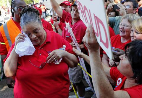 Chicago Teachers Union president Karen Lewis wipes away tears as she greets supporters during a rally Saturday, Sept. 15, 2012 at Union Park.