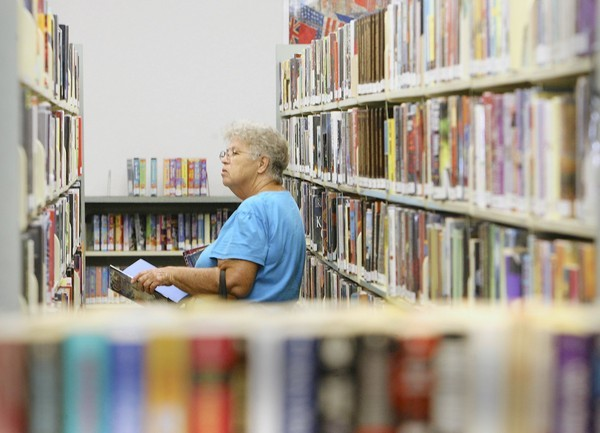 Joan Goodwin, 76, browses through books Thursday, September 13, 2012, at the East Lake County Library. Lake County commissioners are talking about the possibility of cutting library hours and reducing staff as part of an effort to cut property taxes.
