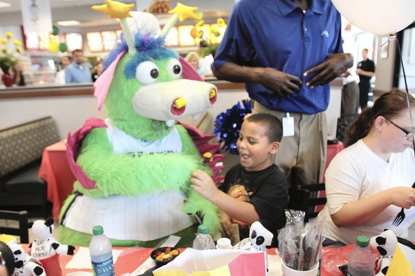 Jayden Spurlin, 7, gets an offer of fruit from Stuff, the Magic mascot. Florida Hospital and The Magic attended an award ceremony at Chick-Fil-A in Maitland. The fast-food franchise won the hospital&#039;s first &quot;Healthy Kids 100 Seal of Approva&quot;l for its new menu item, grilled chicken nuggets.