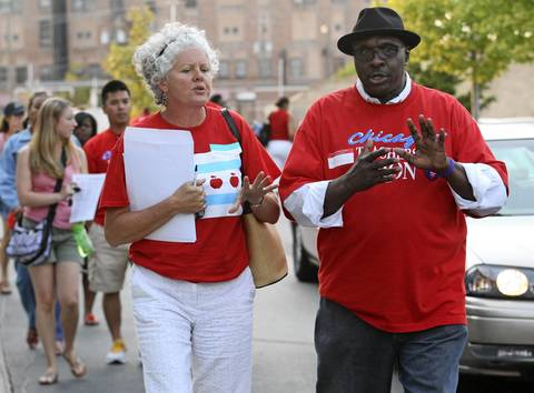 Members of the Chicago Teacher's Union ruling body leave the Operating Engineers Hall after a meeting where it was decided that the teachers strike will continue.