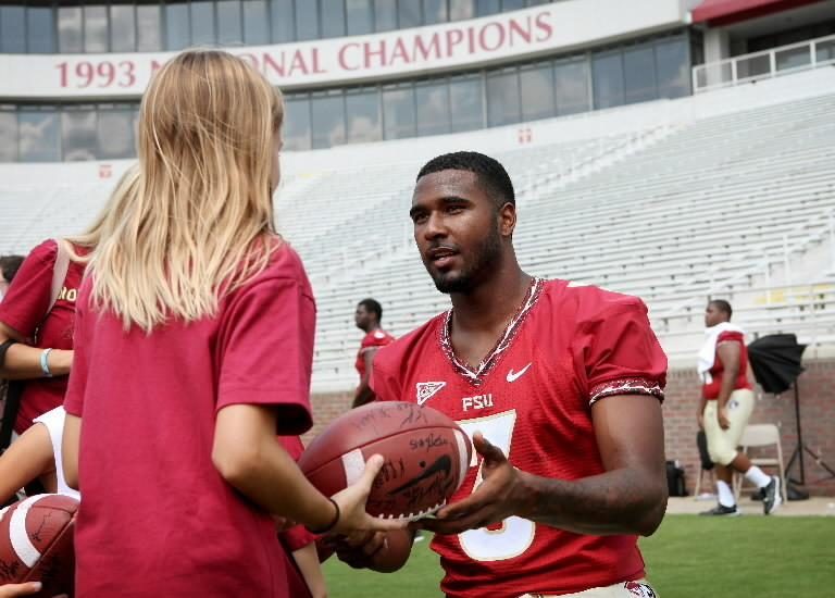 FSU quarterback EJ Manuel, seen here signing an autograph during media day in August, ranks among the most accurate passers in Seminoles history.