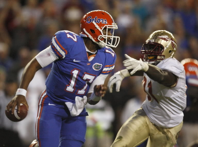 FSU defensive end Cornellius Carradine, right, chases down Florida quarterback Jacoby Brissett during the second half of the Seminoles' 21-7 victory at Ben Hill Griffin Stadium in Gainesville.