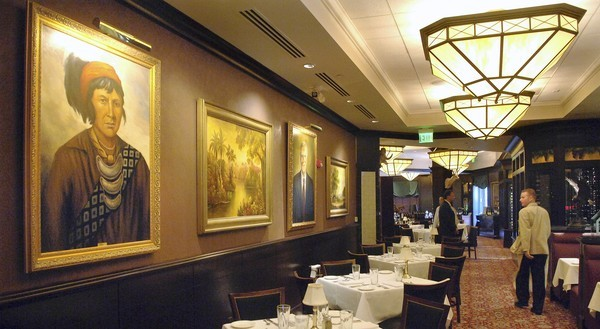 Portraits of prominent Floridians adorn the walls of the numerous dining rooms of Darden's Capital Grille restaurant at Pointe Orlando on International Drive.